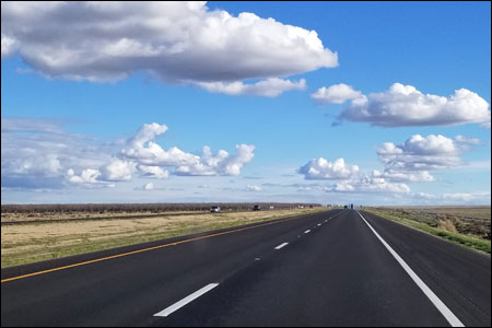 Open road leading to blue sky